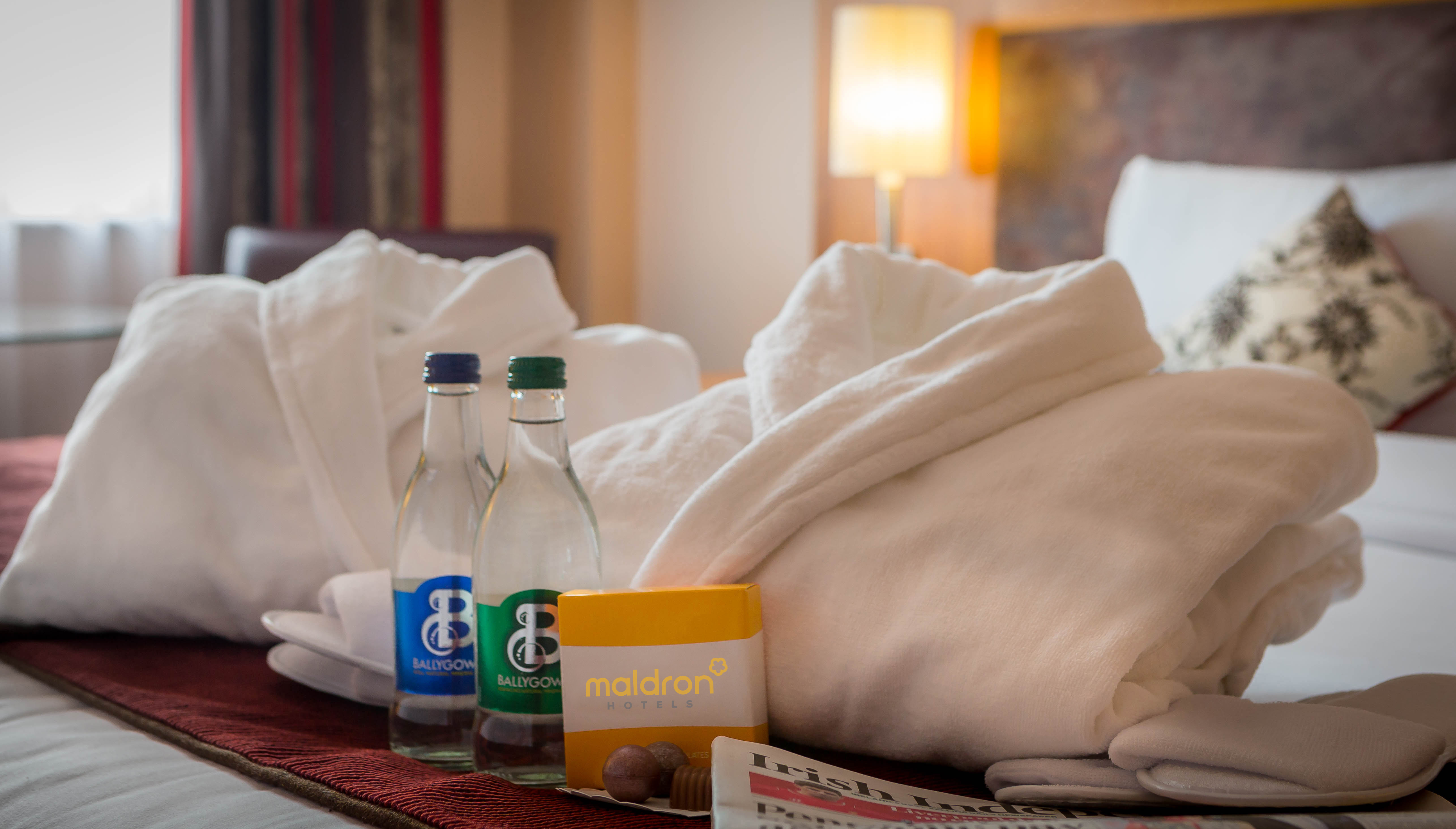 fluffy-bathrobes-and-mineral-water-in-Maldron-Hotel-Parnell-Square-Dublin-Executive-Room